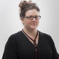 Studio portrait of Dr Justine Lloyd, Visiting Research Fellow.